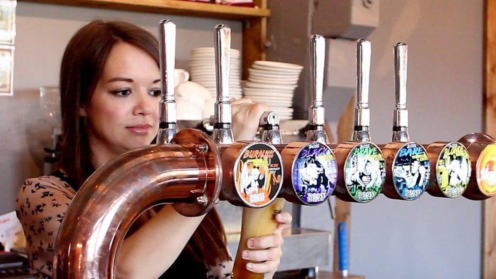 Sarah John pulling a pint