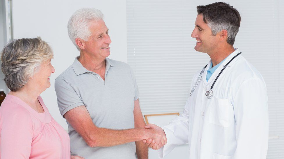 A doctor shaking a patient's hand