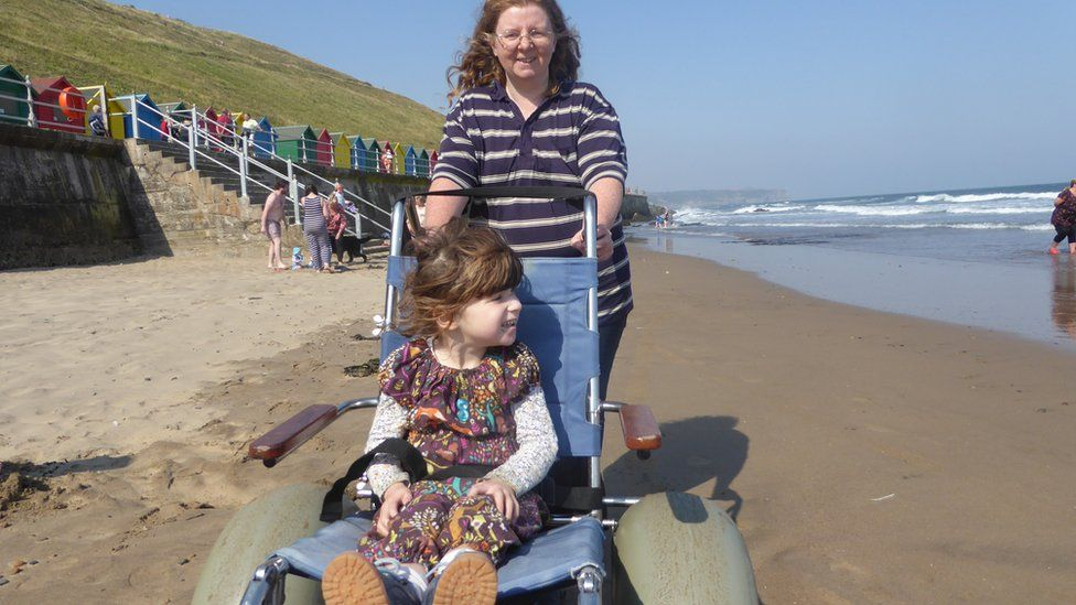 Lorna and her daughter Emily-May on the beach