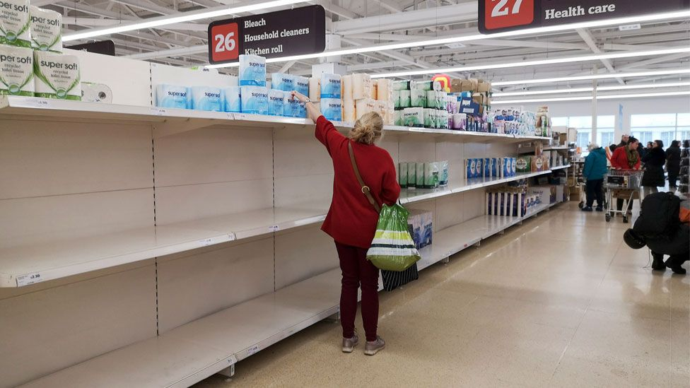A picture shows empty shelves in the tissue paper aisle in a supermarket in London on March 4, 2020.