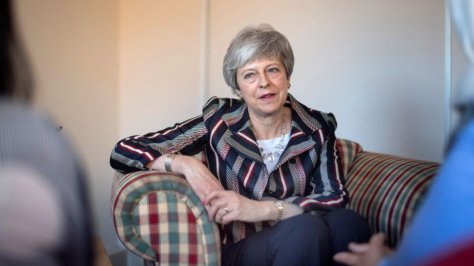 Theresa May at the Advance Charity offices in West London