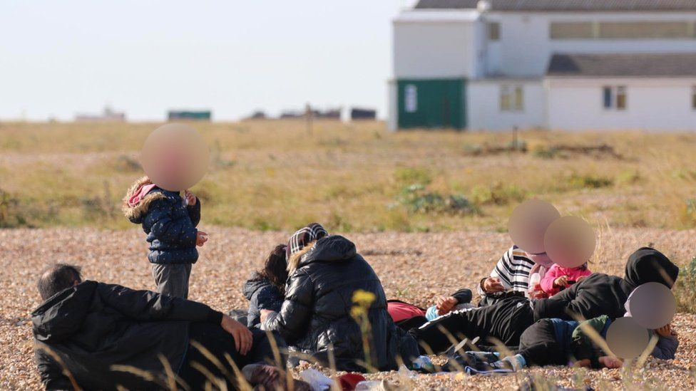 Migrants on Dungeness beach