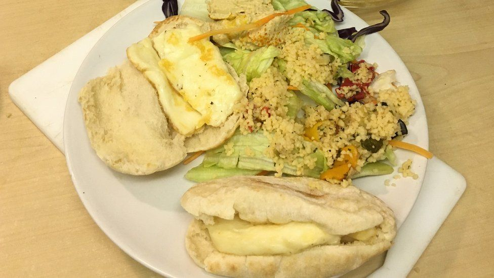 A plate of pitta, couscous and halloumi