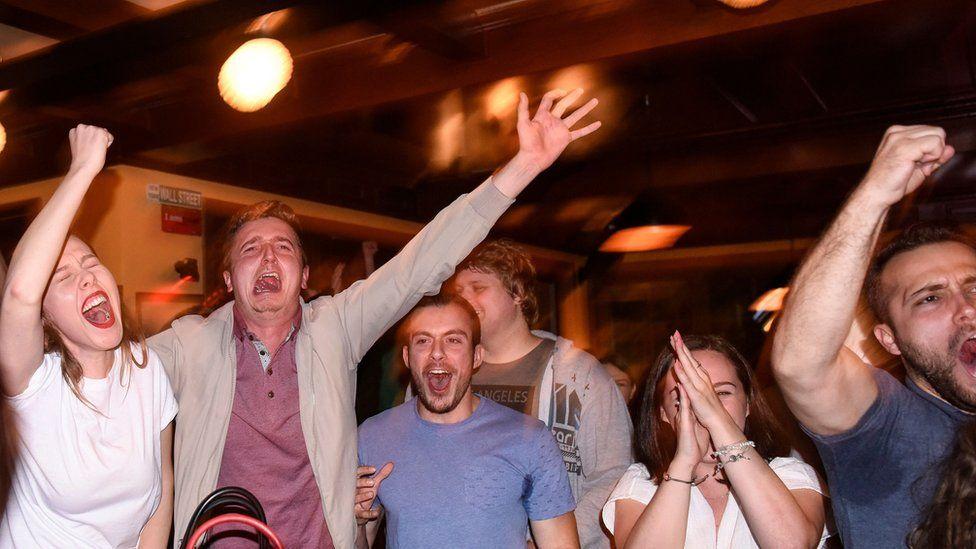 ethnic albanians celebrate the win in Pristina