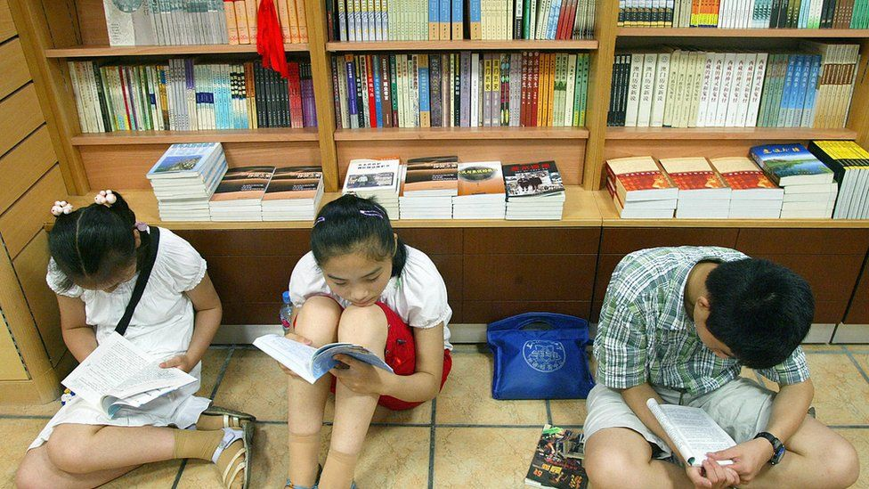 Children reading books in Shanghai