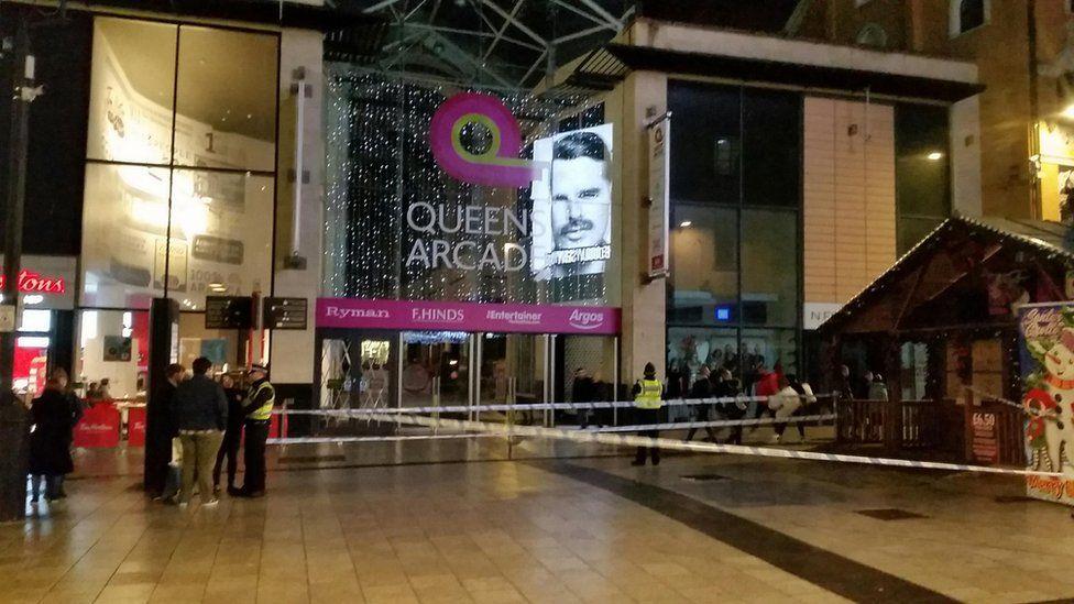 A cordon outside Queen's Arcade in