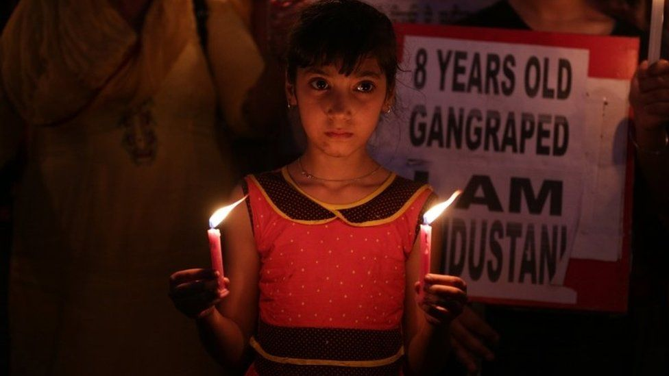 An Indian girl holds candles as she along with her relatives takes part in a candle light march to protest against the rape and murder of eight-year-old girl in Kathua, in Amritsar, India, 15 April 2018