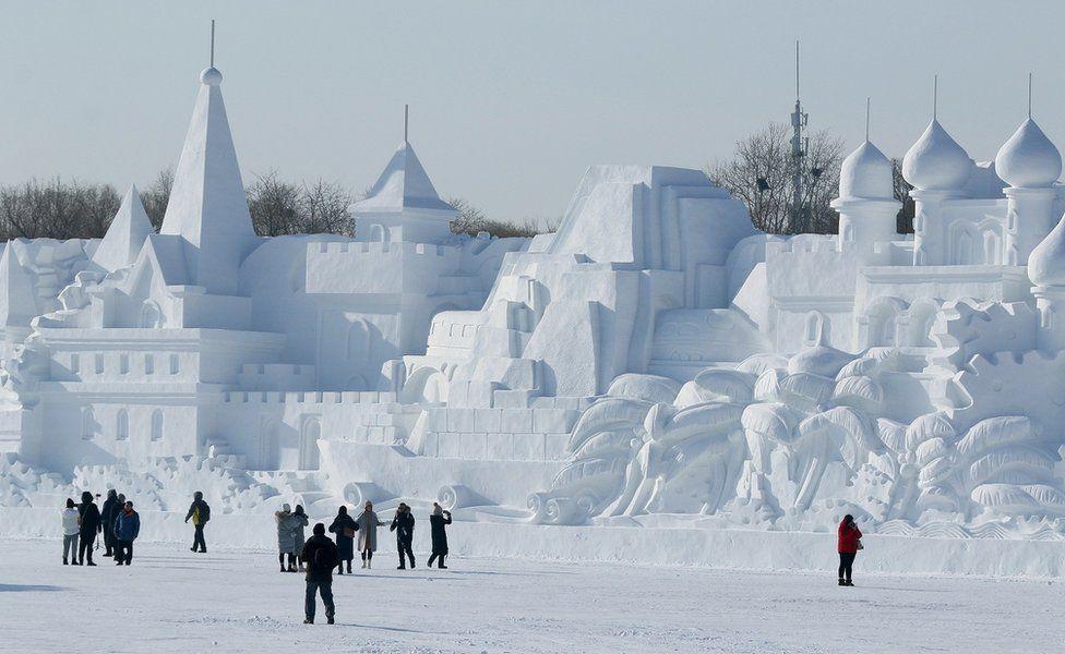 A large snow sculpture of a castle
