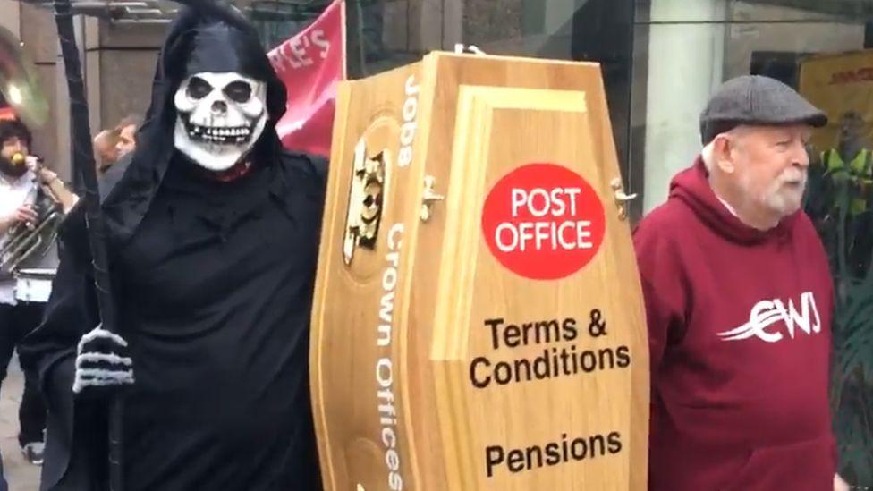 CWU member dressed as Grim Reaper