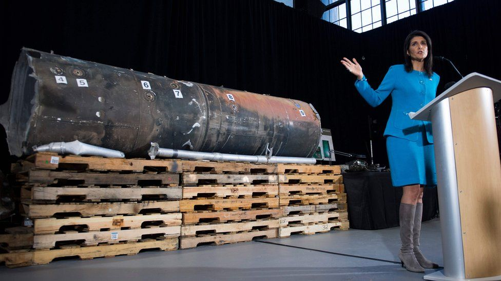 US permanent representative to the UN Nikki Haley gestures towards the remnants of a ballistic missile fired at Riyadh in November