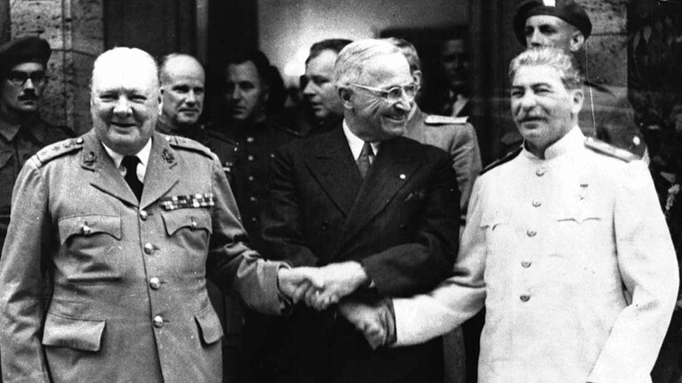 Winston Churchill shakes hands with Harry S Truman and Josef Stalin, Potsdam, 23 July 1945