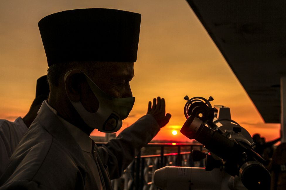 Muslims use a telescope as the sun sets