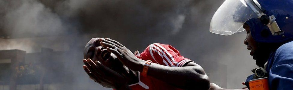 A protester cries as he his detained during a protest in Burundi. File photo