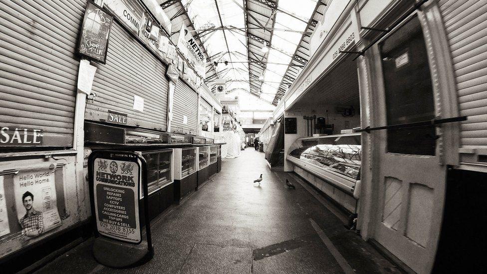 inside empty Cardiff market