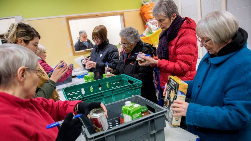 Foodbank volunteers sort through donations at the warehouse before distributing them to local foodbanks on January 28, 2019 in Stalybridge, England.