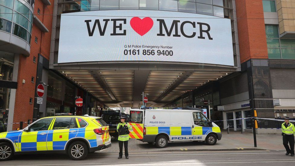 "A large sign reading ""We love Manchester"""