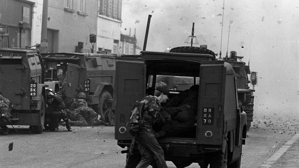 Soldiers running from a bomb in the Smithfield area of Belfast