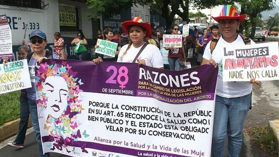 Salvadorean women march demanding the decriminalization of abortion towards the Legislative Assembly in San Salvador on September 28, 2016.