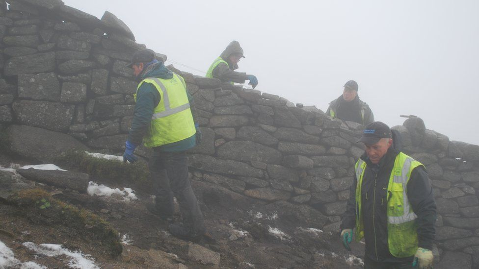 Norman McComb, Martin Stevenson and brothers Brian and Andrew Rooney working on the wall close to the summit of Slieve Donard
