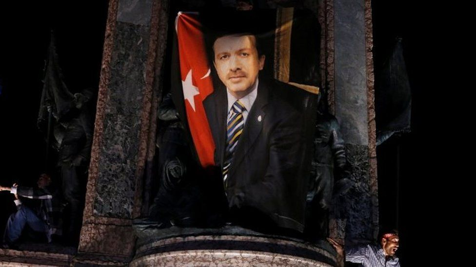 A banner photo of President Erdogan, on the Republic monument during a pro-government demonstration on Taksim Square in Istanbul (21 July 2016)