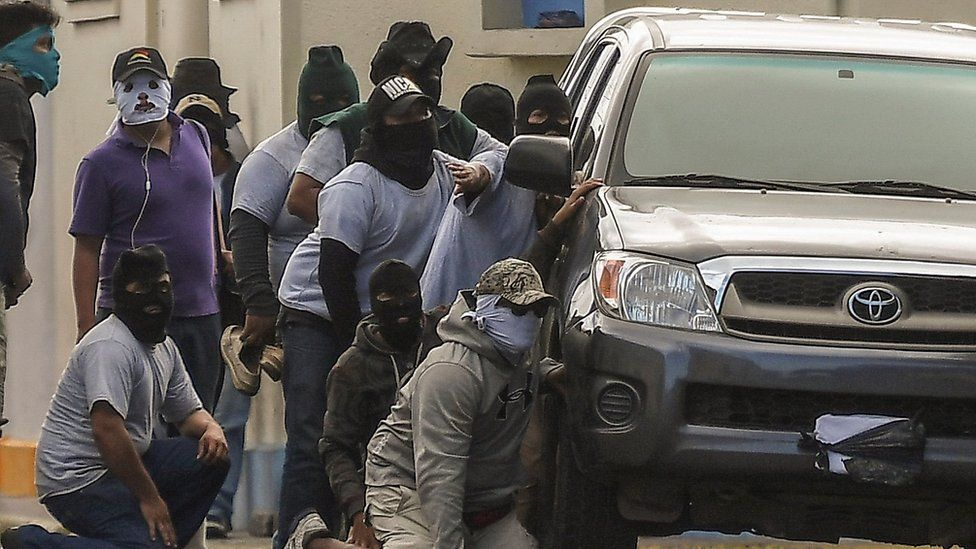 Paramilitaries surround the San Sebastián Basilica, in Diriamba, Nicaragua on July 09, 2018