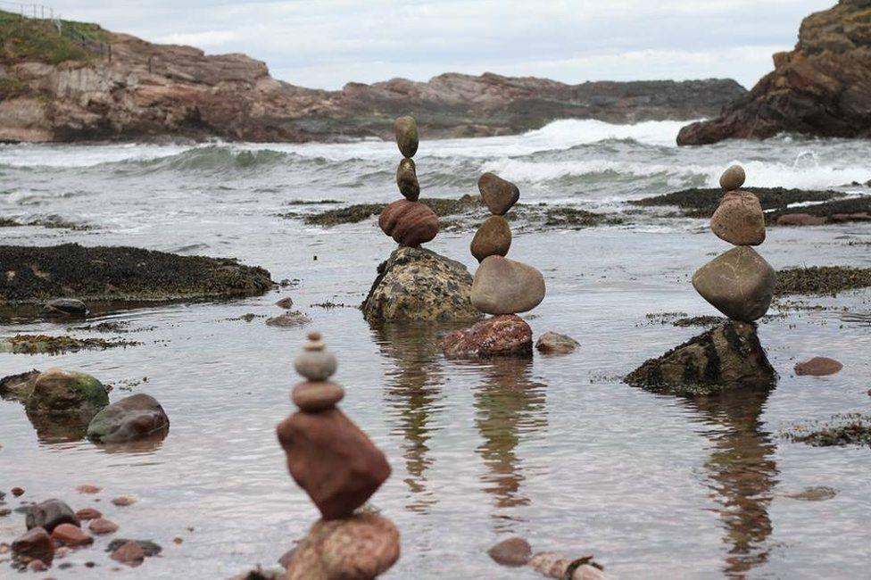 Four small stone stacks