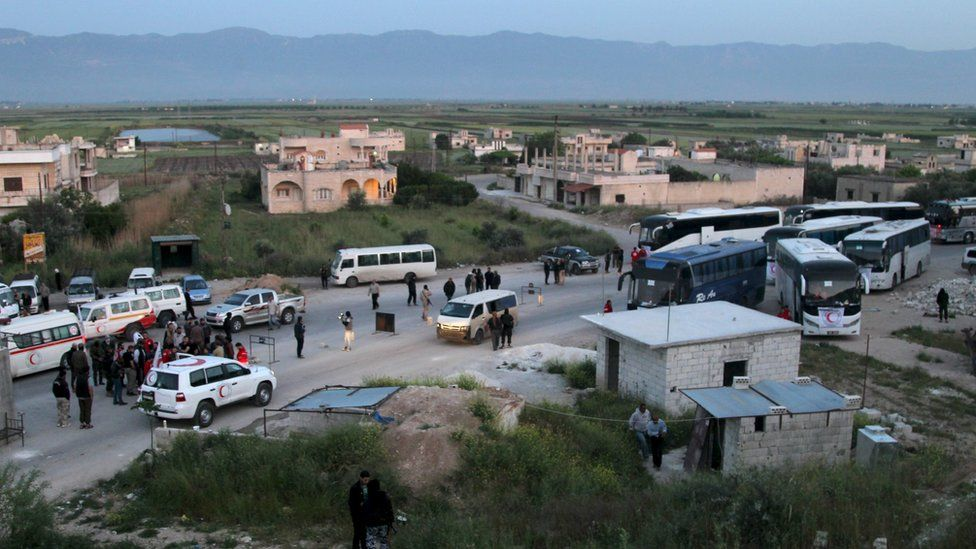 Coaches are parked in the centre of Qalaat al-Madiq, Hama province, where the exchange of evacuees took place on 21 April 2016