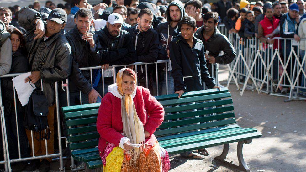 Migrants queuing in Berlin in October 2015