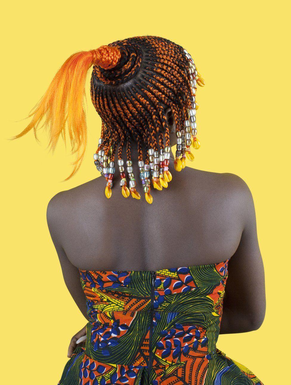 Portrait by Medina Dugger showing African hair braiding