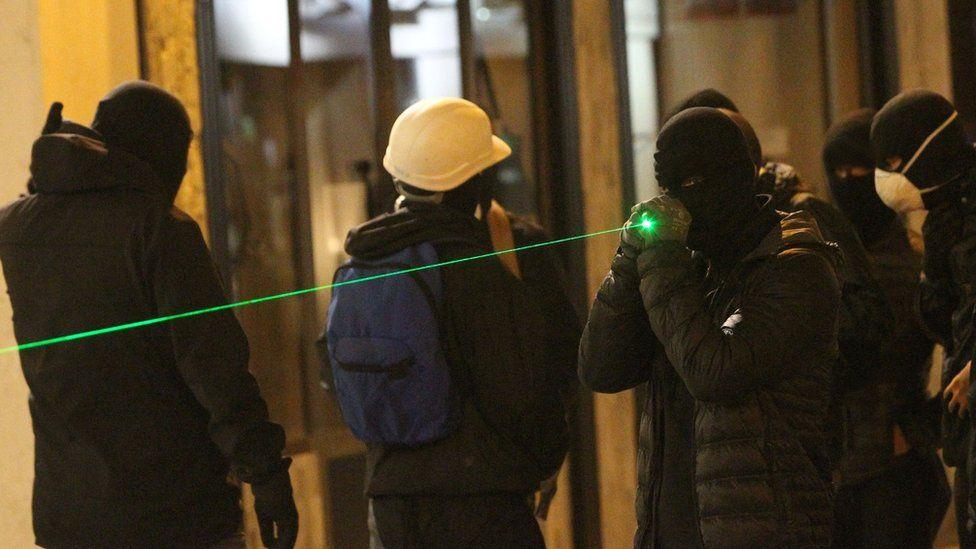 A protester holding a laser pen