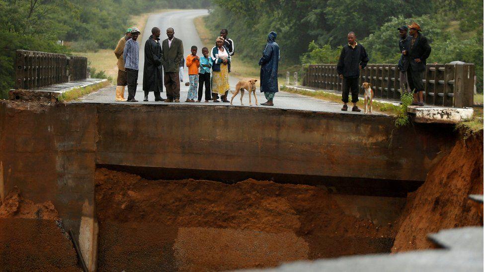 In Chimanimani, Zimbabwe, locals overlook an entire bridge that has been washed away.