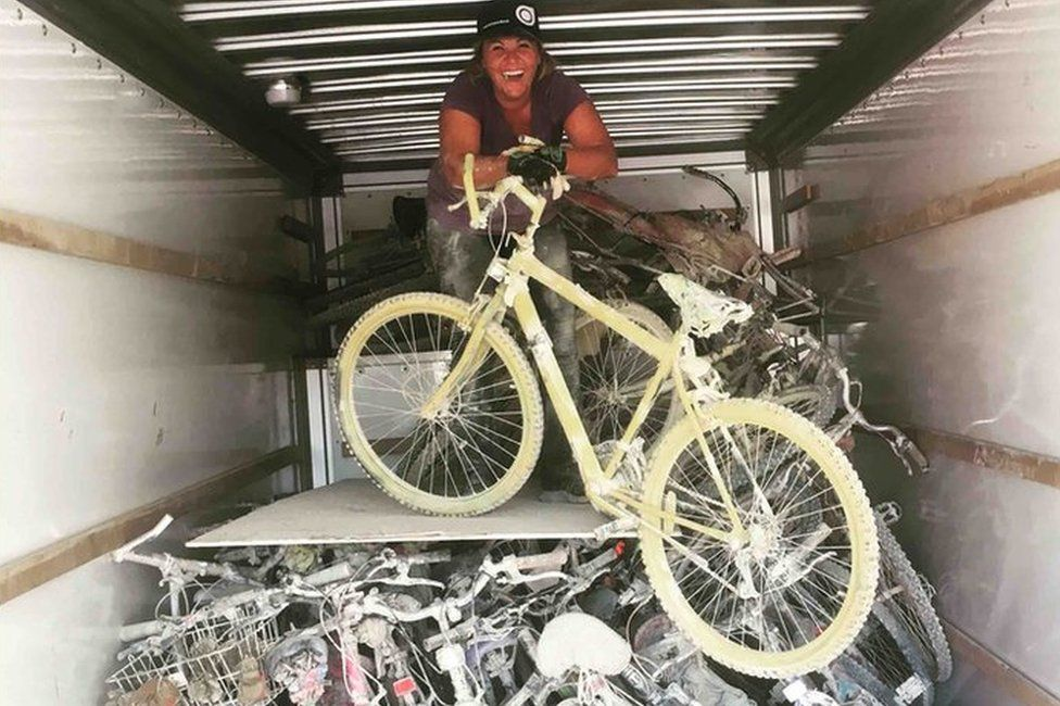 Meg Kiihne loads up a truck with bicycles in the Black Rock Desert