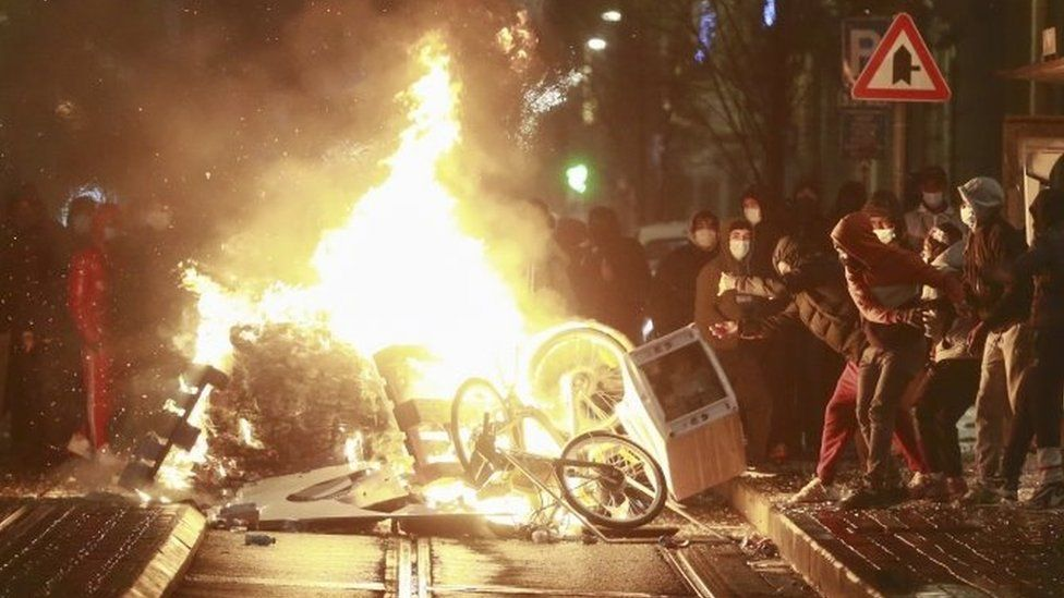 Rioters set a barricade on fire after a protest in demand for justice in the case of Ibrahim