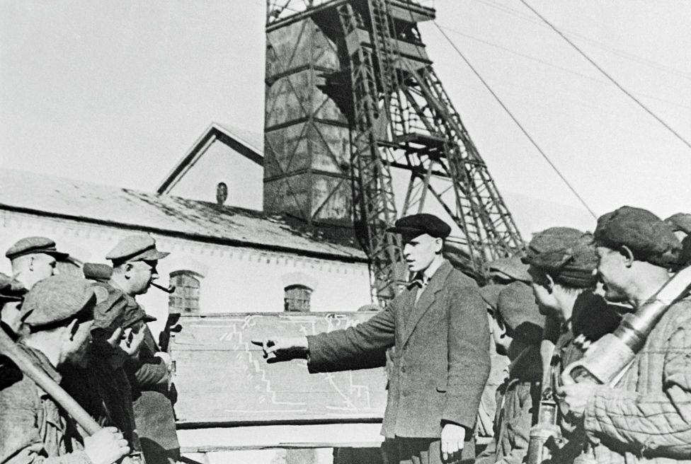 Alexei Stakhanov instructing young miners in 1935