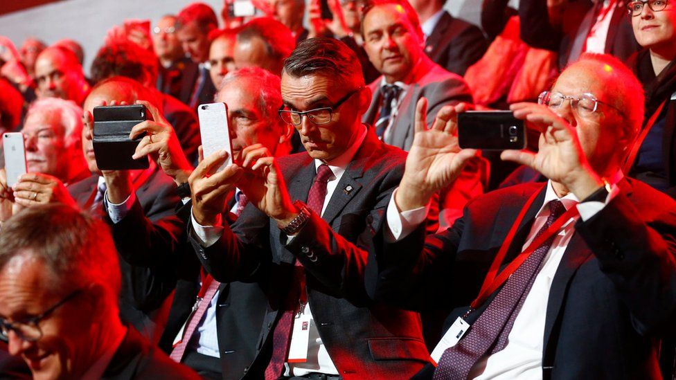 Guests use their mobile devices during the opening ceremony of the NEAT Gotthard Base Tunnel - 1 June 2016