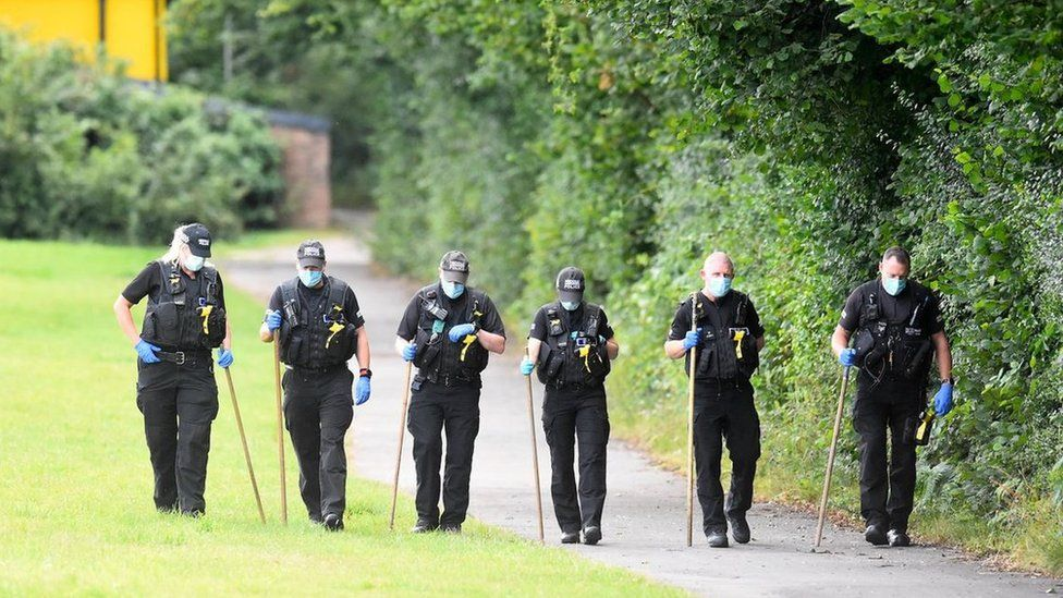 Police conduct searches at the scene