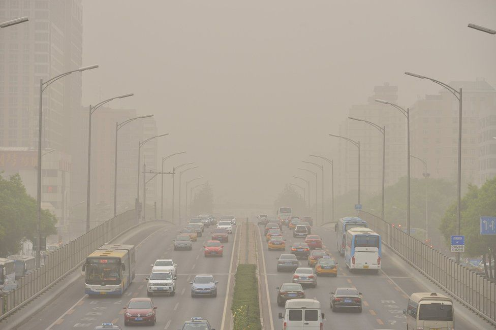 Vehicles are seen on roads during a dust storm in Beijing, China, 4 May 2017