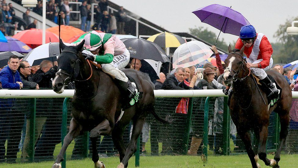 Here Comes When (Left) ridden by Oisin Murphy wins the Unibet Mile during 32Red Sprint Cup Day at Haydock Park