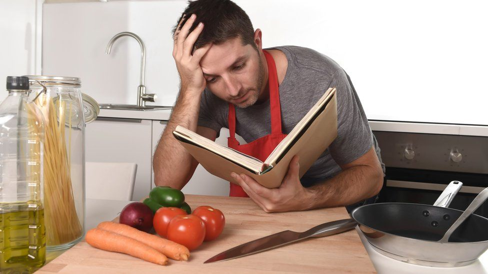 Man looking at cookbook