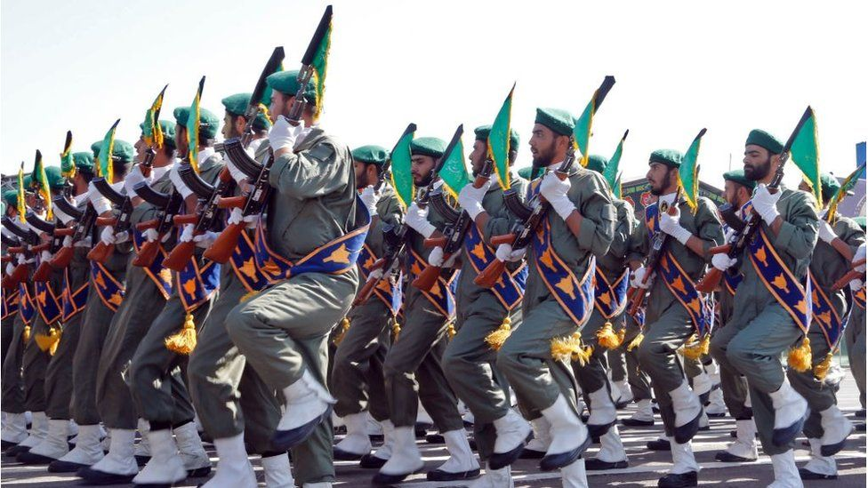 Iranian soldiers march during the annual military parade marking the anniversary of the outbreak of its devastating 1980-1988 war with Saddam Hussein's Iraq, on September 22,2017 in Tehran