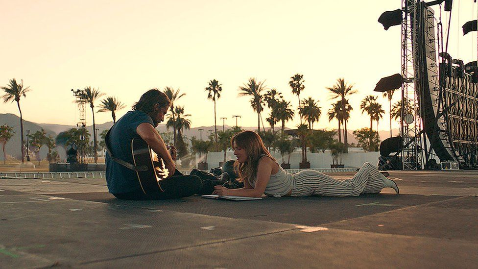 Bradley Cooper (pictured with Lady Gaga) makes his directorial debut with A Star is Born