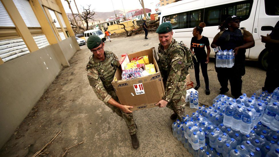 British soldiers carrying food aid in the British Virgin Islands