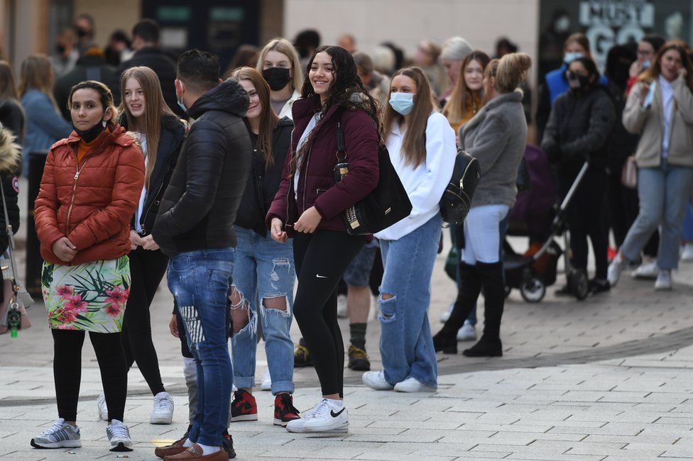 A group of customers queue outside Primark