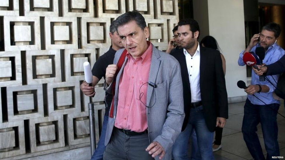 Greek Finance Minister Euclid Tsakalotos leaves a hotel following an overnight meeting with Greece's creditors