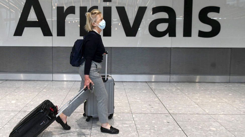 Woman arriving at Heathrow