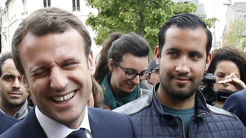 """The then French presidential candidate Emmanuel Macron (C) of the """"En Marche"""" political movement flanked by security staff Alexandre Benalla (R) during an election campaign visit in Rodez, France, 05 May 2017"""
