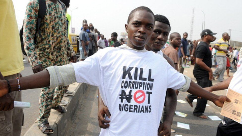 A protestor sports a an anti-corruption T-shirt on January 9, 2012 in Lagos during a demonstration against the more than doubling of petrol prices after government abolished fuel subsidies.