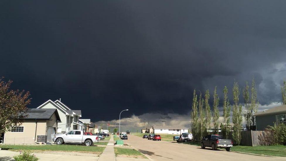 Cecilia Wessels' photo of a tornado above near Three Hills, Canada