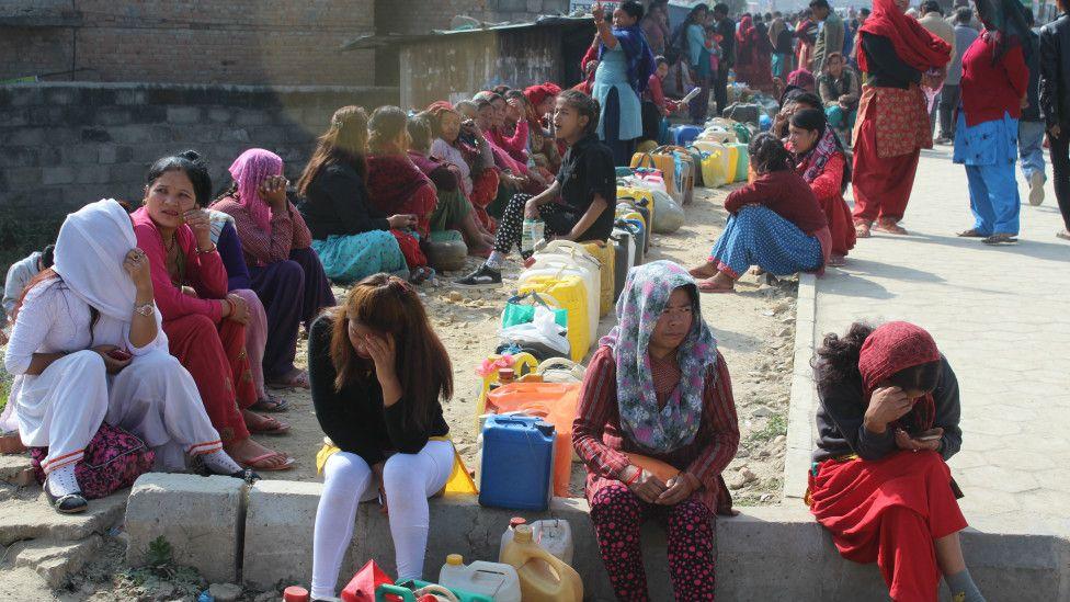 People queuing for kerosene oil