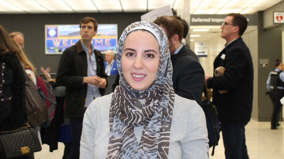 Lawyer Lena Albibi at Dulles International Airport in Virginia